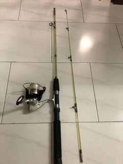 "Used 5'6""ft  Spinning fishing rod and Tomman reel"
