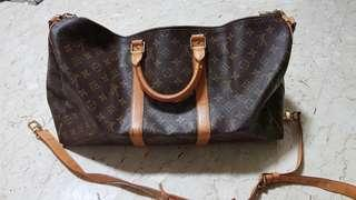 7aac26dd6e89 Authentic Louis Vuitton Keepall 55 with Strap