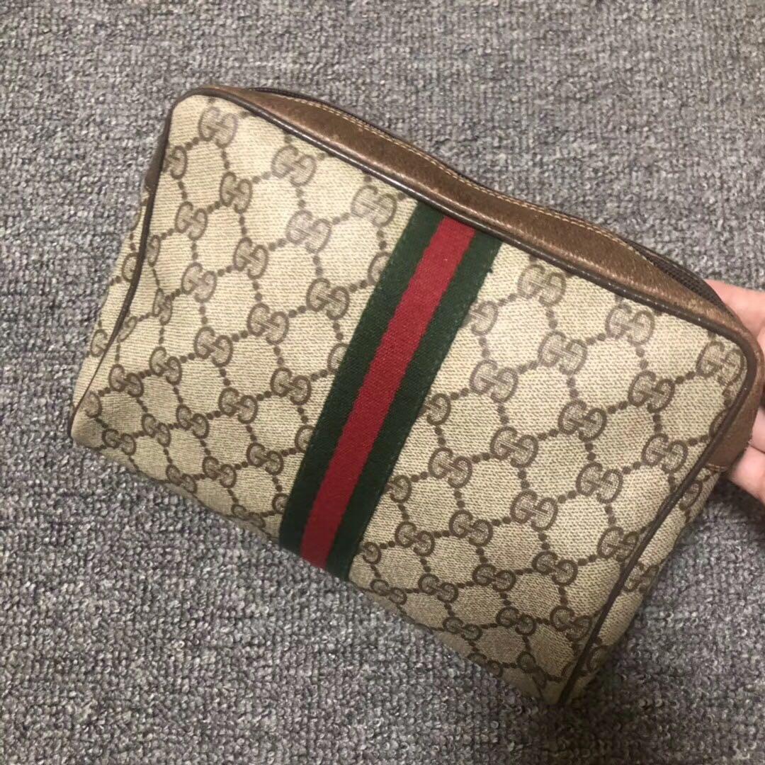 afdd880438a Authentic vintage Gucci clutch bag