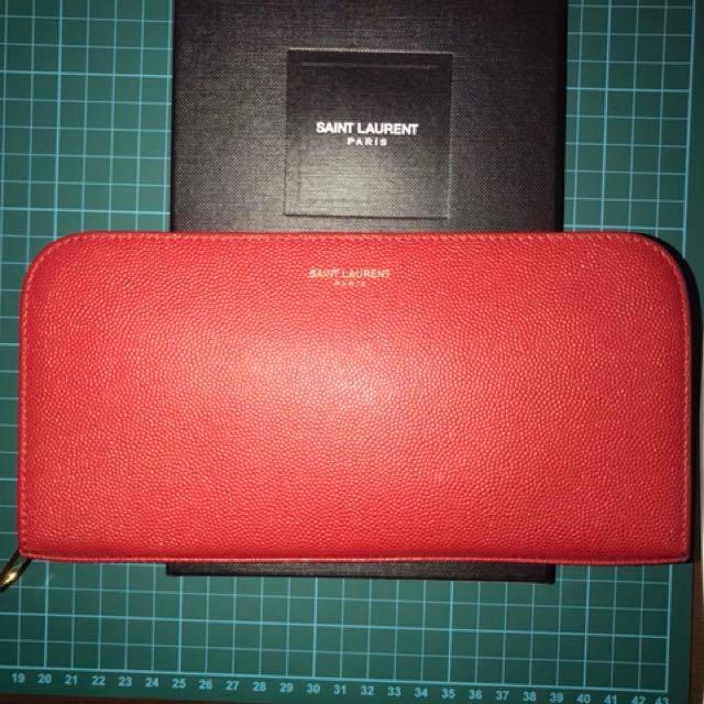c57548bfda9 YSL Saint Laurent long zip wallet, Luxury, Bags & Wallets on Carousell