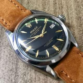 Vintage Rolex 6534 Glossy Black Gilt Oyster Perpetual Date