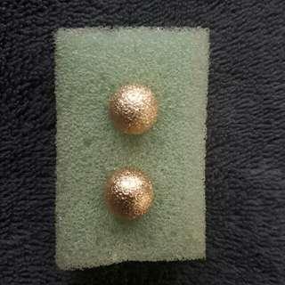 gold ball earrings and silver hoop earrings