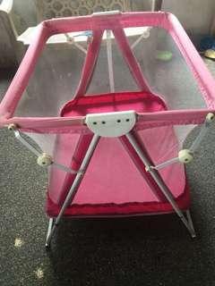 Baby crib in fuchsia in pink
