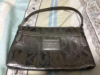 Michael Kors Clutch 100%real $150. New but with scratches