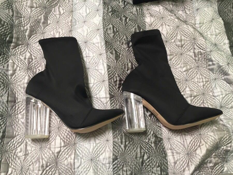 Black boots with clear heel