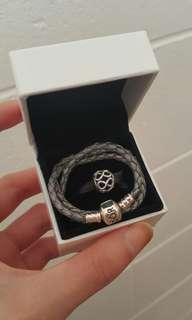 Pandora leather bracelet + charm