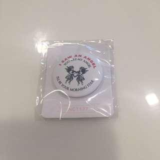 Official NCT 127 lyrics badge/pin from SMTOWN