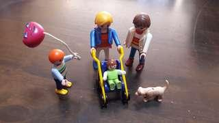 Playmobil family set of four with a dog