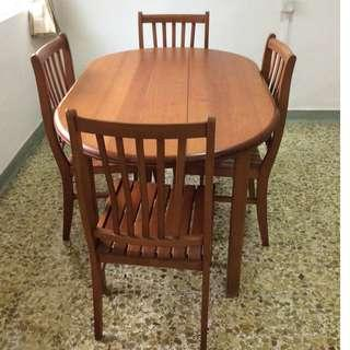 Oval wooden dining table with 4 chairs