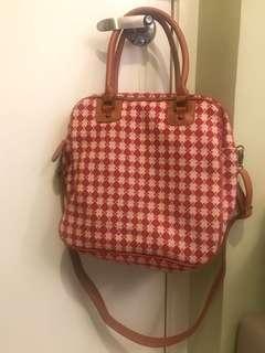 4-way wearing red handbag