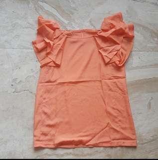 Orange blouse with frill sleeve