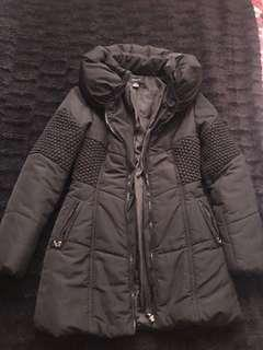 Black body hugging winter jacket
