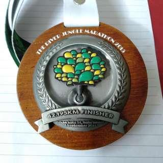 Jungle marathon run medal