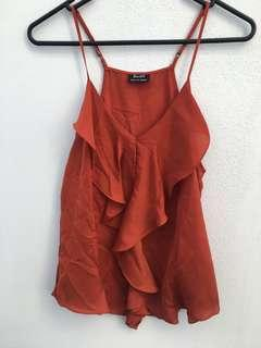Bardot rust coloured top size 8