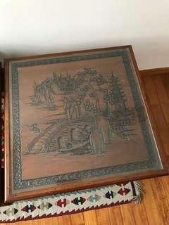 Side table with carvings