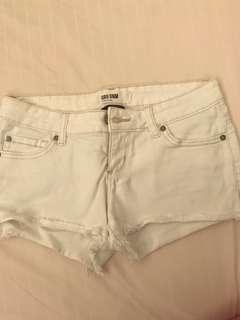 White frayed shorts