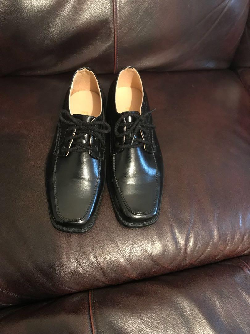 New boys black shoes