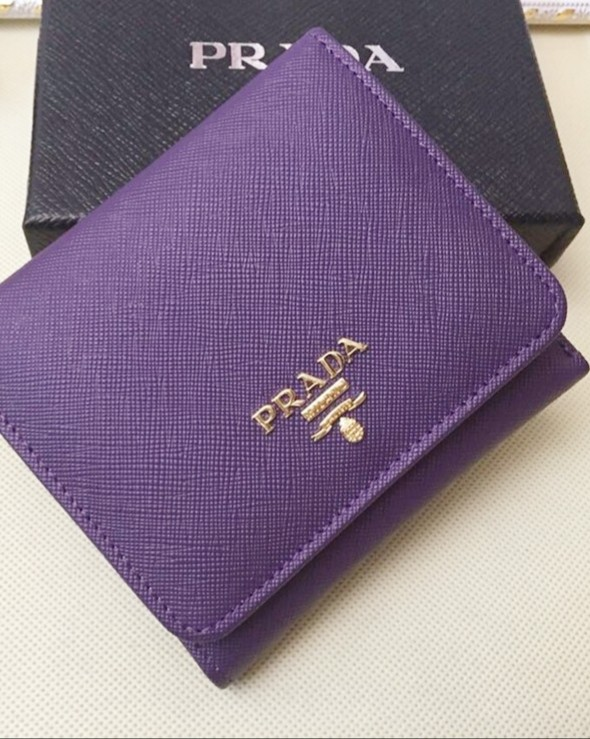 ec1845286873 Preloved Prada Saffiano Trifold Wallet in purple, Luxury, Bags & Wallets,  Wallets on Carousell