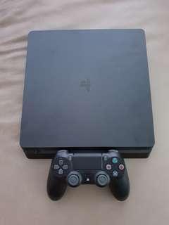PS4 Slim + 1 Year Warranty
