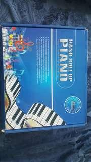 Hand roll up piano