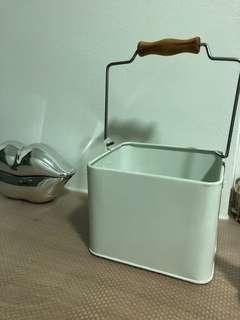 White metal basket with wooden handle