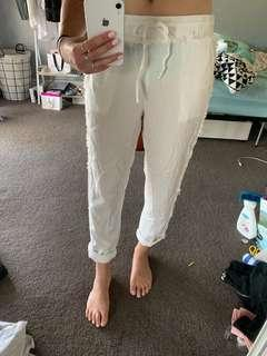 White relaxed pant worn frayed edge