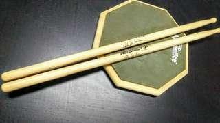 Evans practice drum pad/ Van Halen signature series drum stick.