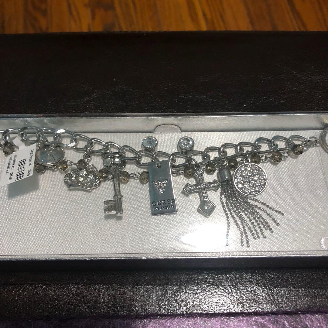 Guess charms bracelet and earrings