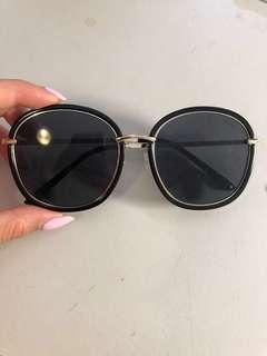 Black sunnies with gold detail