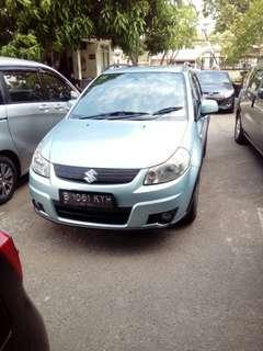 Suzuki x over