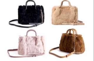 black furry sling bag