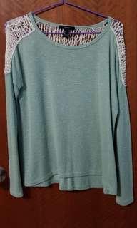 green long sleeve top