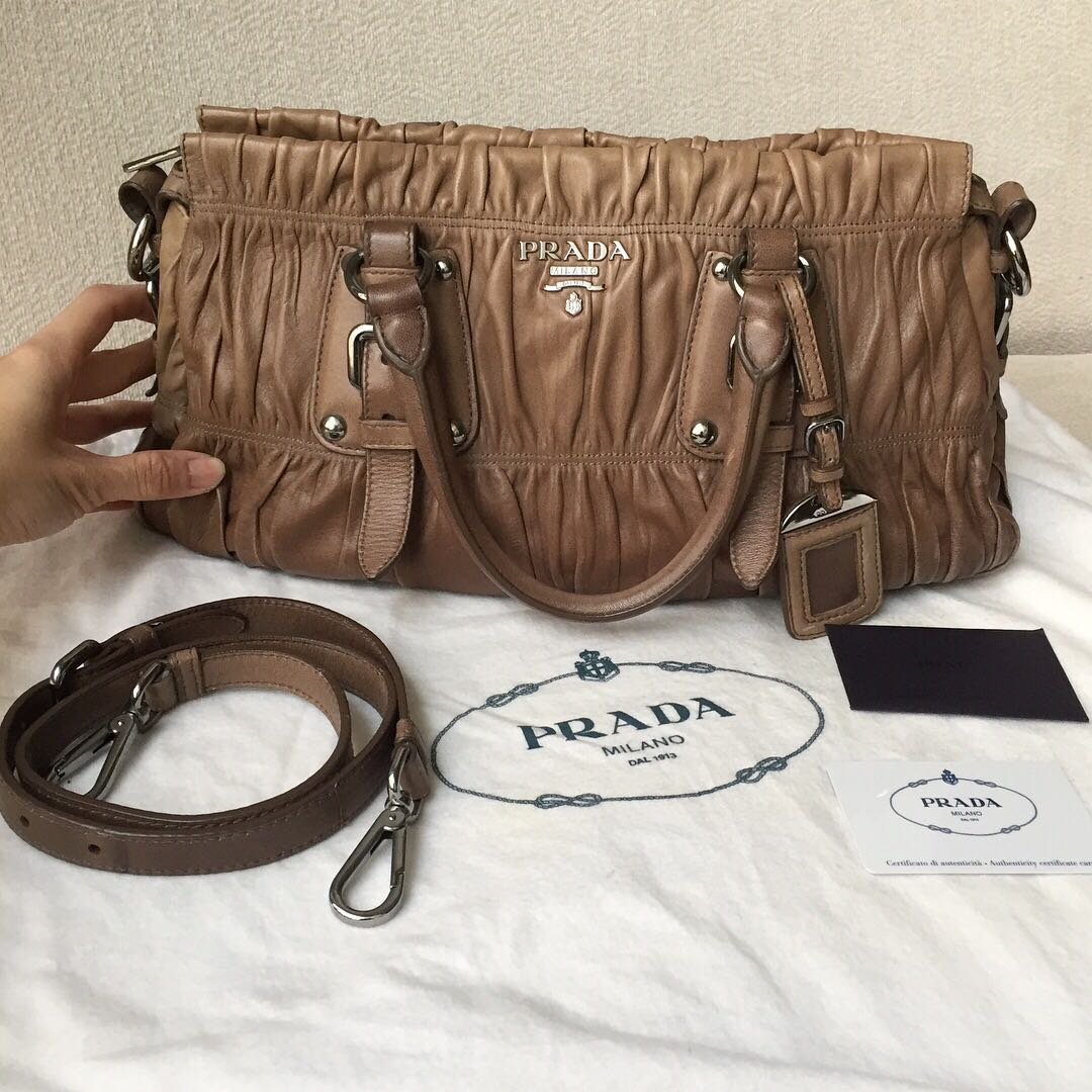 9f32233f850a AUTHENTIC PRADA Nappa Gaufre Sling Bag BN1407