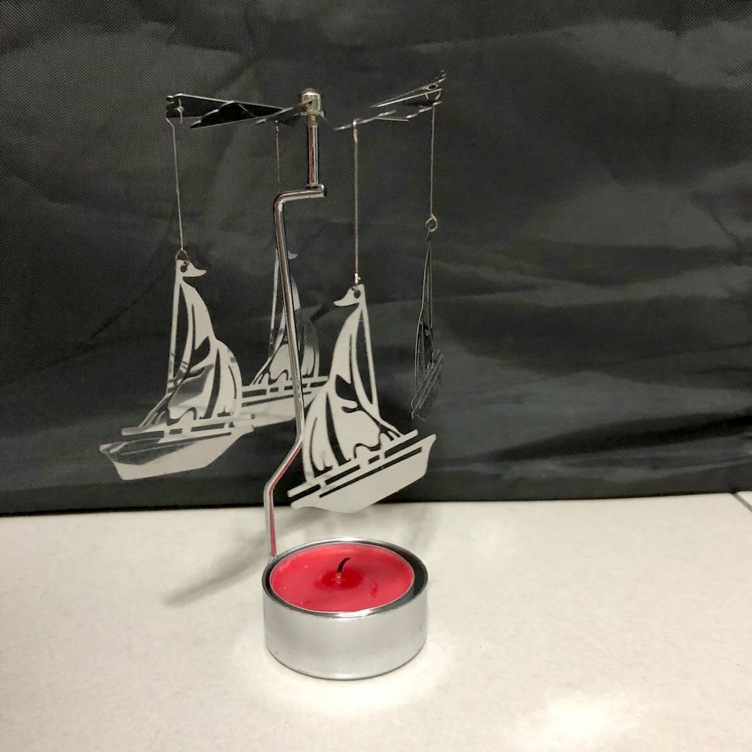 Rotating sailboat candle holder