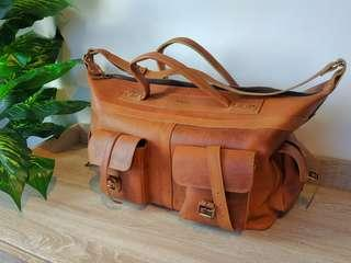 Full Leather Big duffel bag with strap. RUST