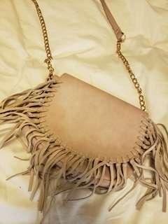 Pink crossbody bag with tassels