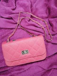 Pink clutch quilted bag