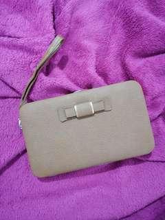 Brown ribboned clutch bag/wallet