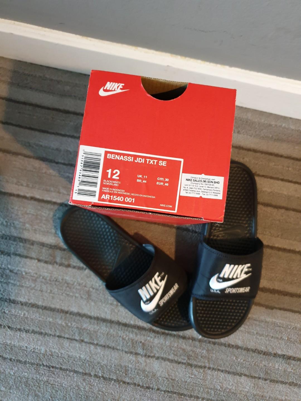 best website 511dc 8d375 Benassi JDI TXT SE US12 Nike Slippers, Men s Fashion, Footwear, Slippers    Sandals on Carousell