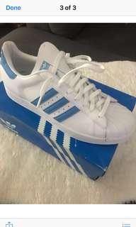 Adidas white leather with blue stripes shell toe. Size 11