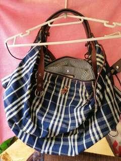 Woman's leather cloth bag