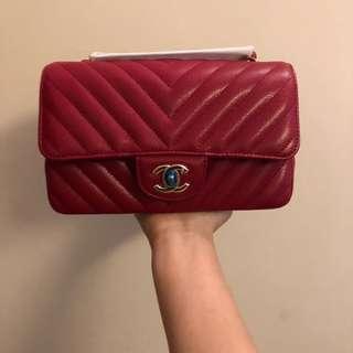 Brand new Chanel chevron rectangular mini flap bag in red caviar with light gold hardware 20cm
