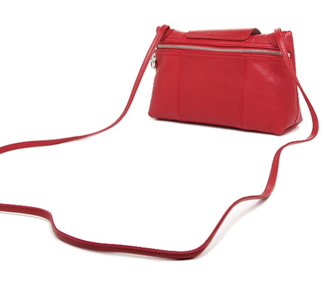 15541ba3cac6 Longchamp Le Pliage Cuir Crossbody in Red