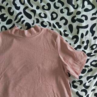 pink oversized turtle neck shirt