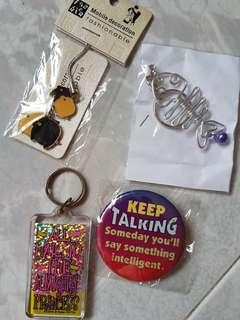 Assorted items: 2 keychains, 1 badge, 1 mobile strap