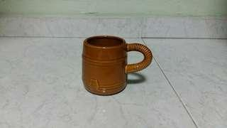 Brown ceramic tea coffee cup