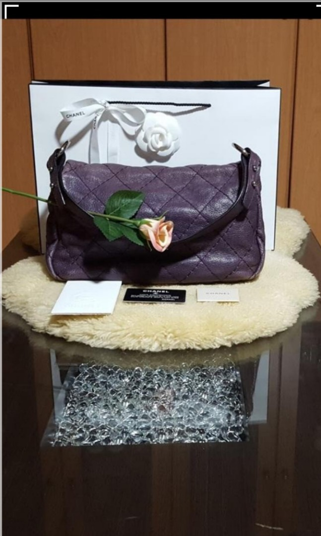 69b11dfee5a3 Authentic Chanel purple 💜Quilted Leather On The Road Flap Bag, Luxury, Bags  & Wallets, Handbags on Carousell