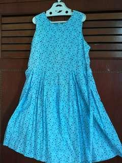 Girl blue dress with colourful hearts