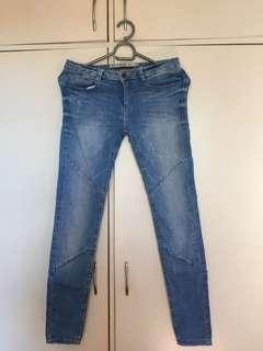 Distressed skinny biker jeans