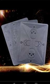 Black poker playing cards skull